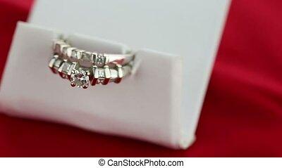 Wedding ring in a white silk
