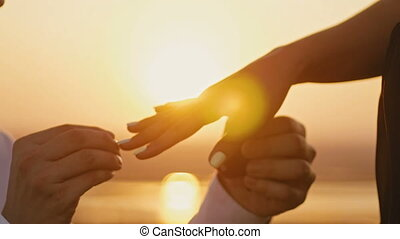 Wedding Ring Put On Finger Hands Touching Sunset Bride Groom...