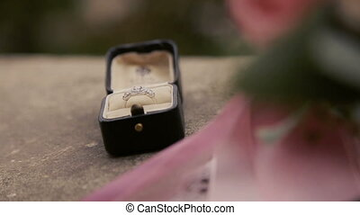 Wedding ring with diamond on the ground close up