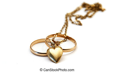 wedding rings and a golden heart