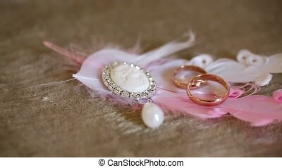 Wedding rings and feathers - Two wedding rings and feathers