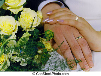 wedding rings and hands - married couple showing their rings...