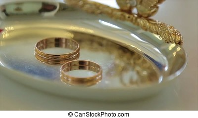 Wedding rings and rose. Wedding jewelry and rings. The Beauty Wedding Ring on a box. Rings of love. Selective focus. Wedding Ring Spinning, Rotating. Golden wedding rings