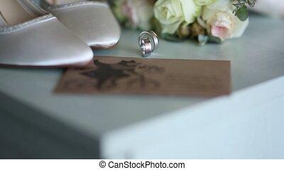 Wedding rings and wedding shoes bride. Wedding jewelry.