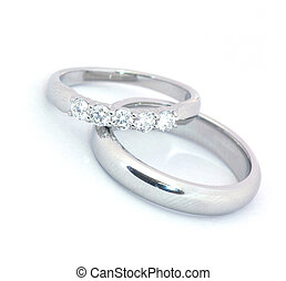 Closeup of wedding bands on a white background.