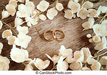 Wedding rings in a middle of flowers