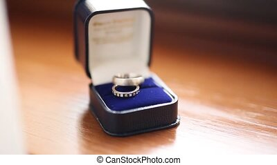 Wedding rings in blue box for the ring