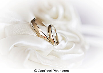 wedding rings in high key - pair of wedding rings on a white...