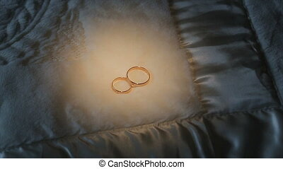 Wedding rings in the light of a lantern