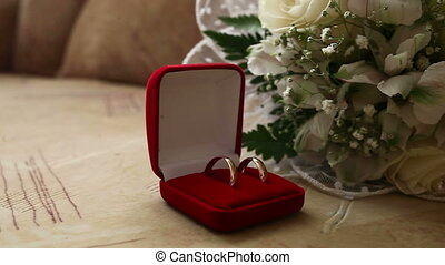 Wedding rings in the red box in the background bridal...