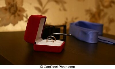 wedding rings in video the red box on the table - wedding...