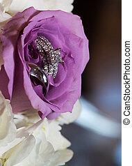 Wedding rings inside flower