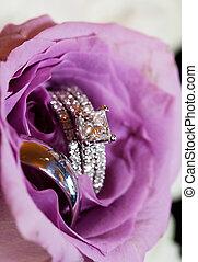 Wedding rings inside rose