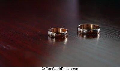Wedding rings lie on a wooden table. wedding day - Wedding...
