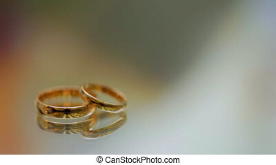 wedding rings lie on the surface