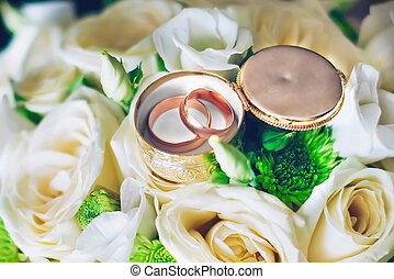 wedding rings on a bouquet of flowers