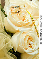 Wedding rings on a bouquet of roses