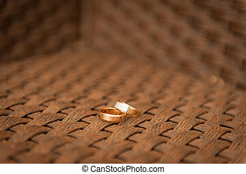 wedding rings on a dense fabric of the chair