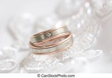 Wedding rings on a dress