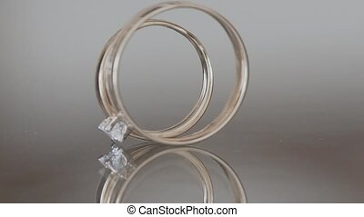 Wedding rings on a homogeneous background