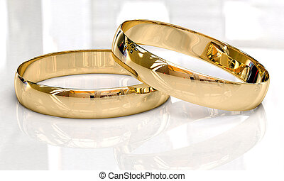 Wedding rings on a light background with reflections.