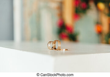 wedding rings on a wooden floor