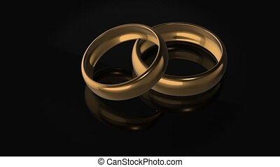 Wedding rings on black background