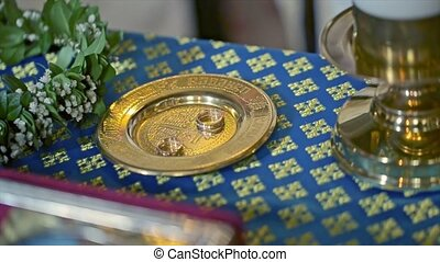 Wedding Rings on Ceremony in the Church Table