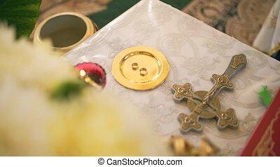 wedding rings on church altar
