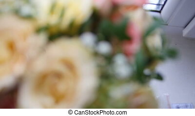 Wedding rings on flowers - rack focus, close up
