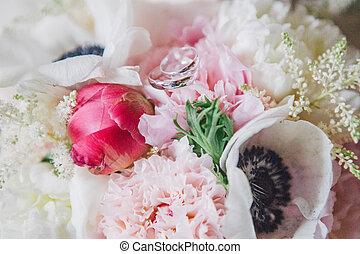 wedding rings on flowers - wedding rings on colorful...