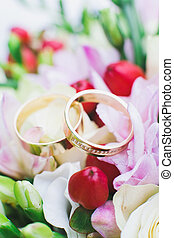 wedding rings on flowers - wedding rings on pink and red...