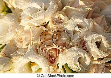 Wedding rings on flowers.