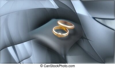 Wedding rings on grey pillow