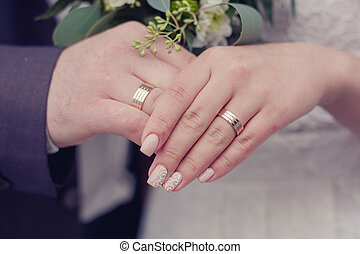 Wedding rings on hands. - Two hands close - the bride and...