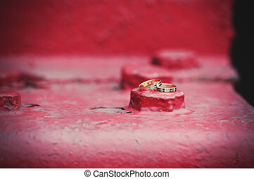 wedding rings on industrial background