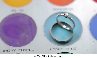 Wedding rings on makeup palette