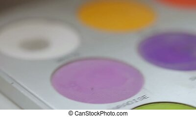 Wedding rings on makeup palette closeup