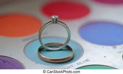 Wedding rings on makeup palette