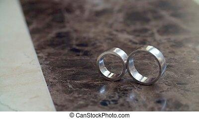 Wedding Rings on Marble Floor - Wedding Ring Spinning on...