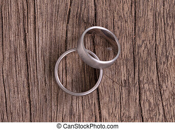 Wedding rings on old wood