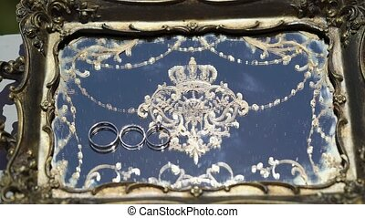 Wedding rings on platter
