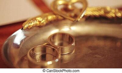 Wedding rings on table - Rasfokus on wedding rings lying on...