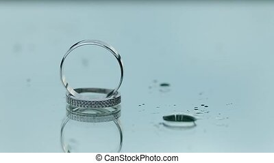 Wedding Rings on the Glass in Rainy Weather