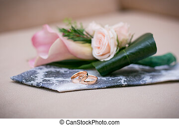 Wedding rings on the groom's tie