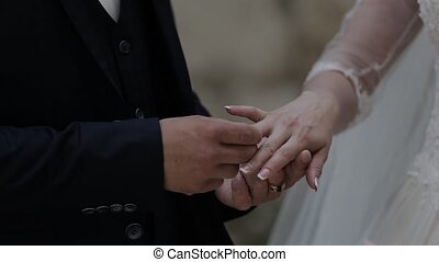 Wedding rings on the hand of young people