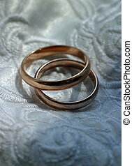 Wedding rings on the white atlas