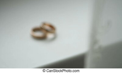 Wedding rings on the white table, background