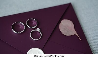 Wedding rings on violet background - Wedding rings on violet...
