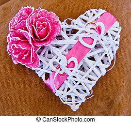 wedding rings on white heart